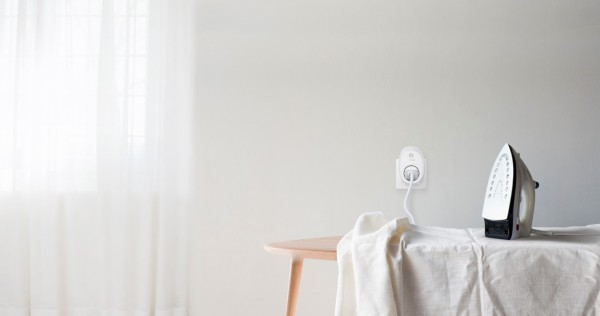 White tablecloth and iron on ironing board